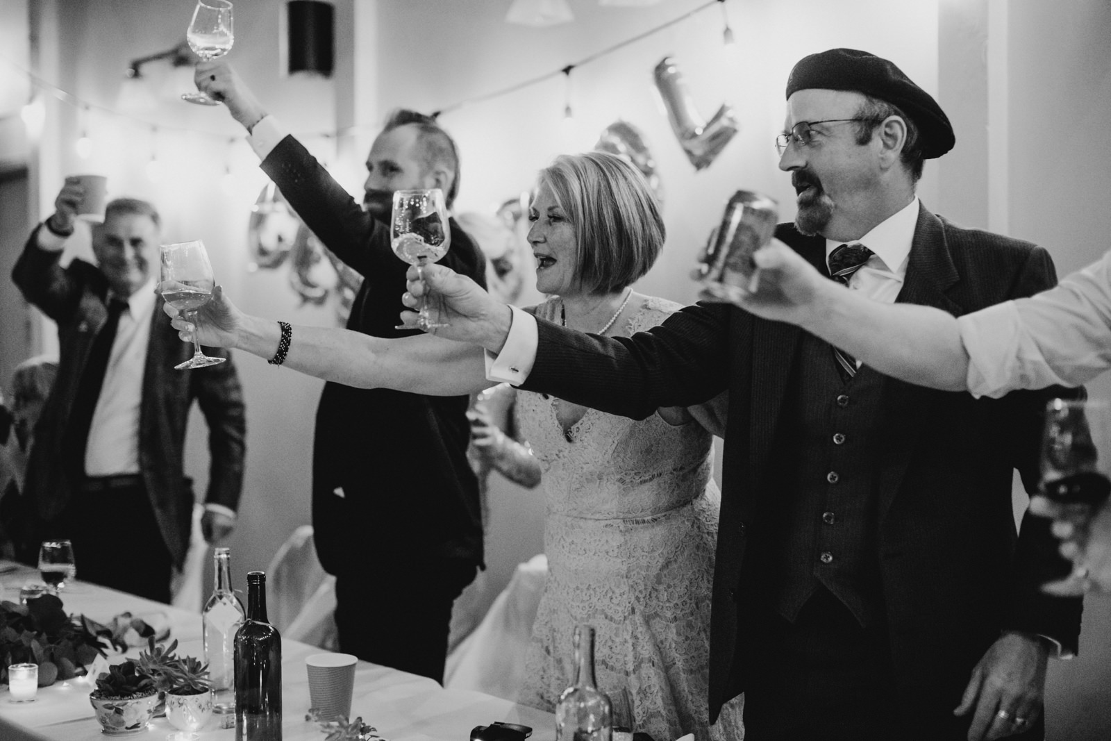 family cheers at wedding reception, victoria wedding photographer