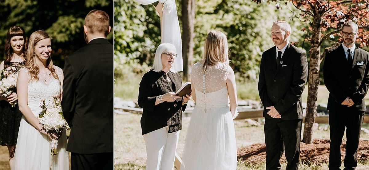 bride and groom exchange vows at farm wedding vancouver island wedding photographer