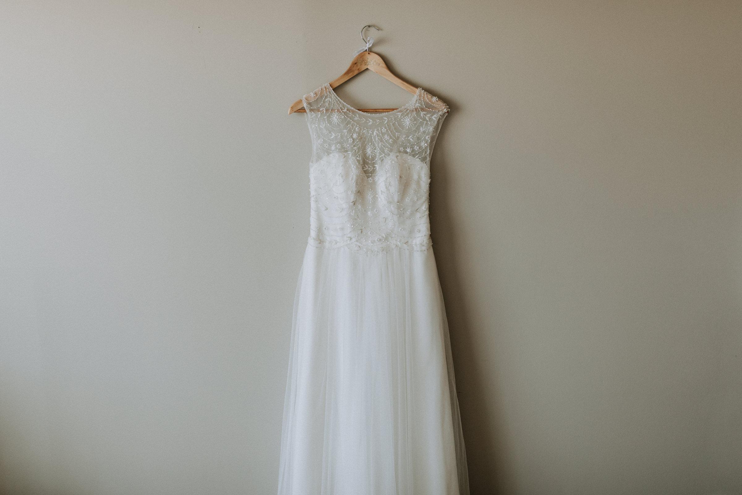 wedding dress on wall vancouver island wedding photographer