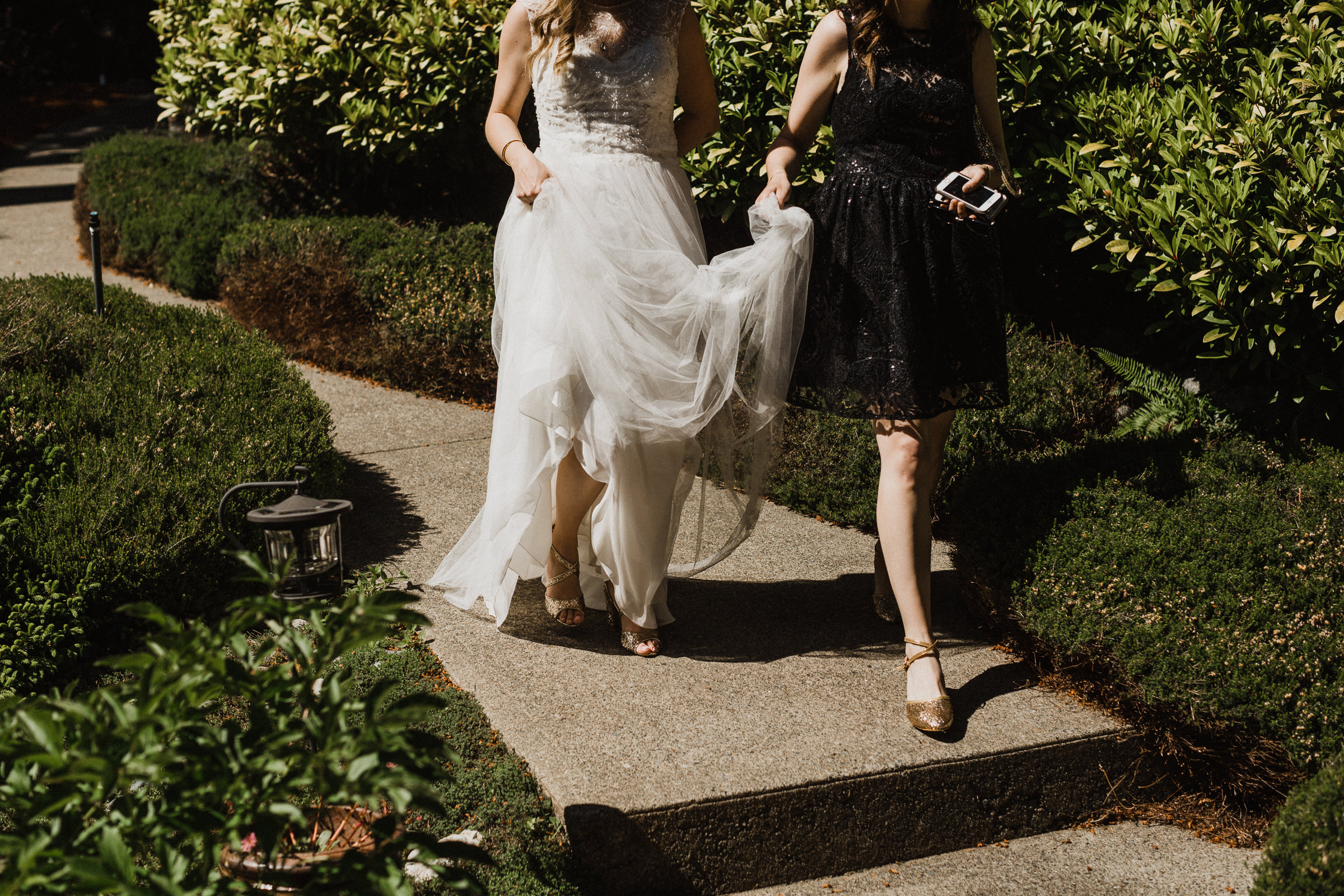 bride walks down path to groom vancouver island wedding photographer