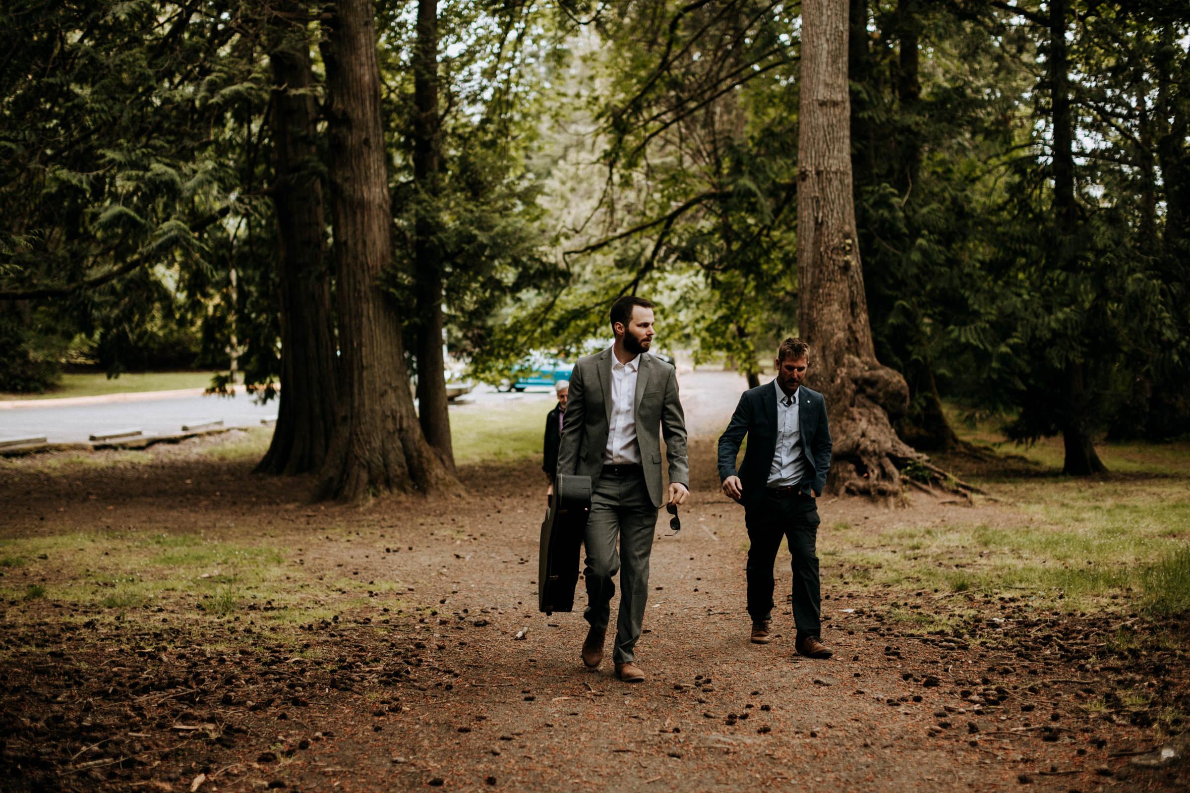 groomsmen walk to forest elopement at Mount Doug in Victoria BC