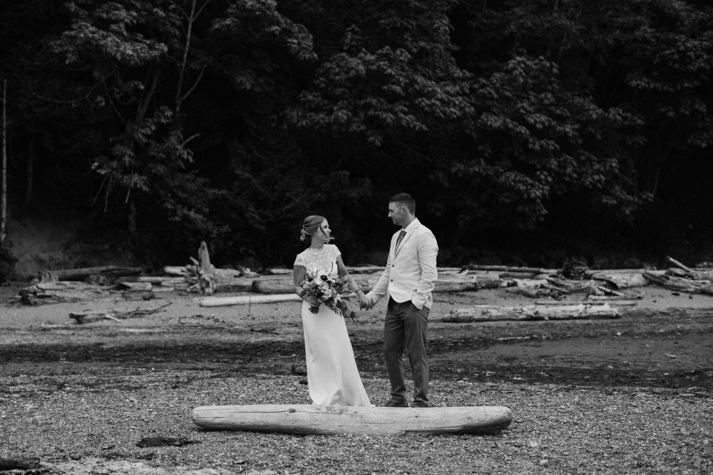 bride and groom hold hands on beach, west coast elopement