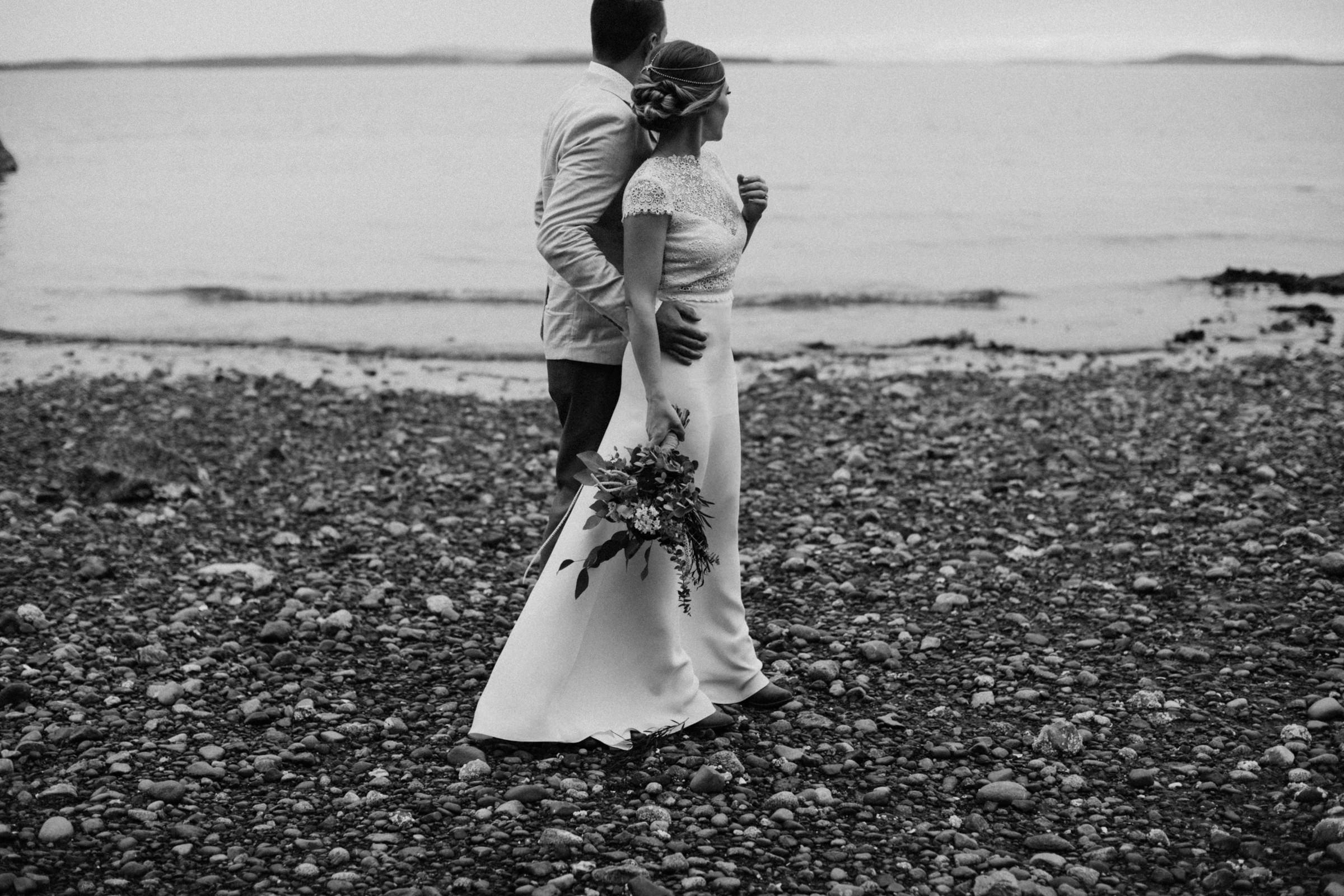 bride and groom look to ocean, west coast elopement photographer