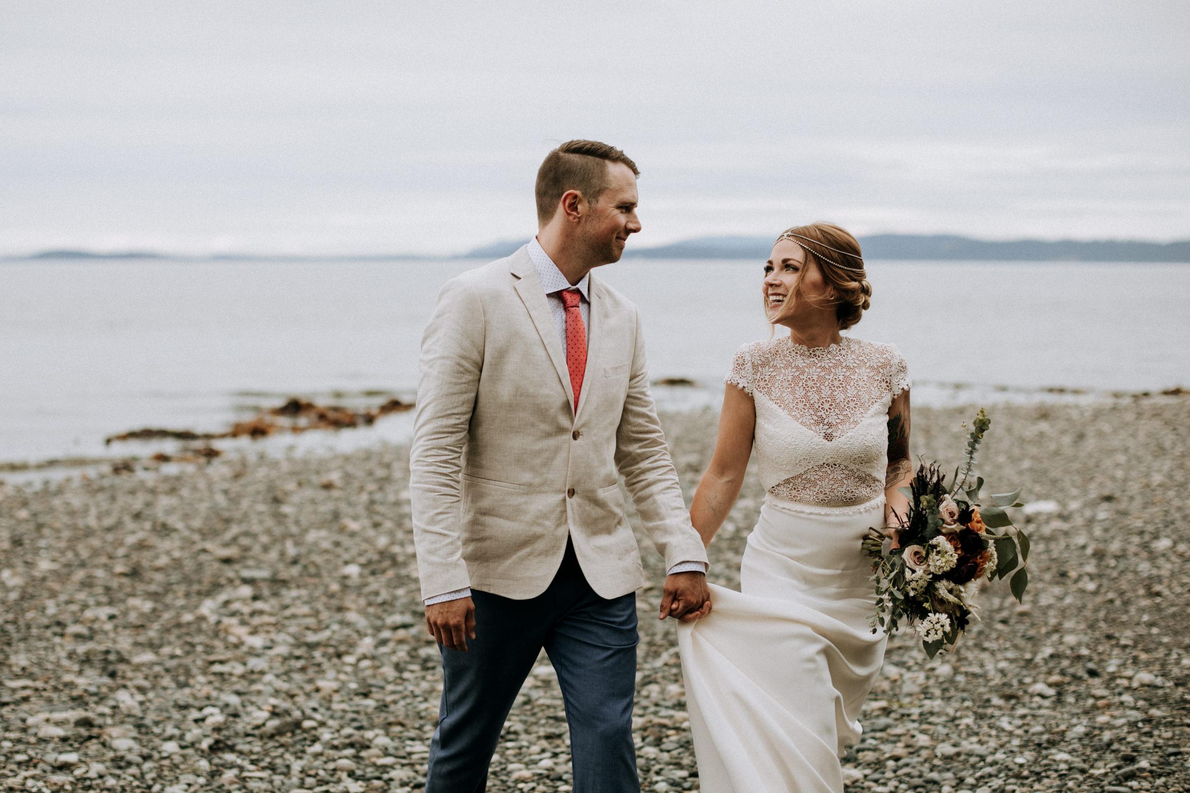 bride and groom walks on beach to ceremony, Victoria elopement photographer