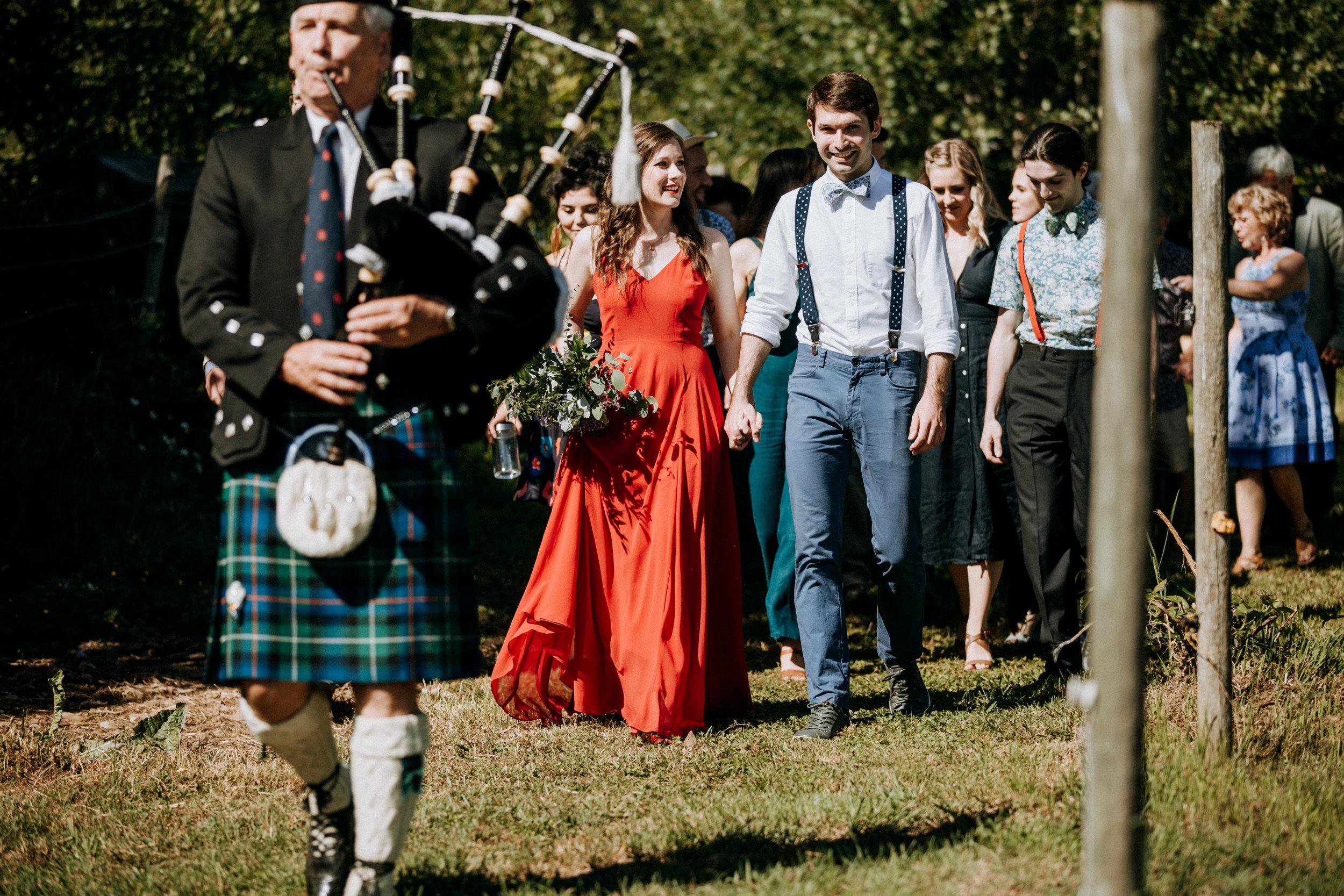 bagpiper walks bride and groom to ceremony Courtenay Wedding Photographer