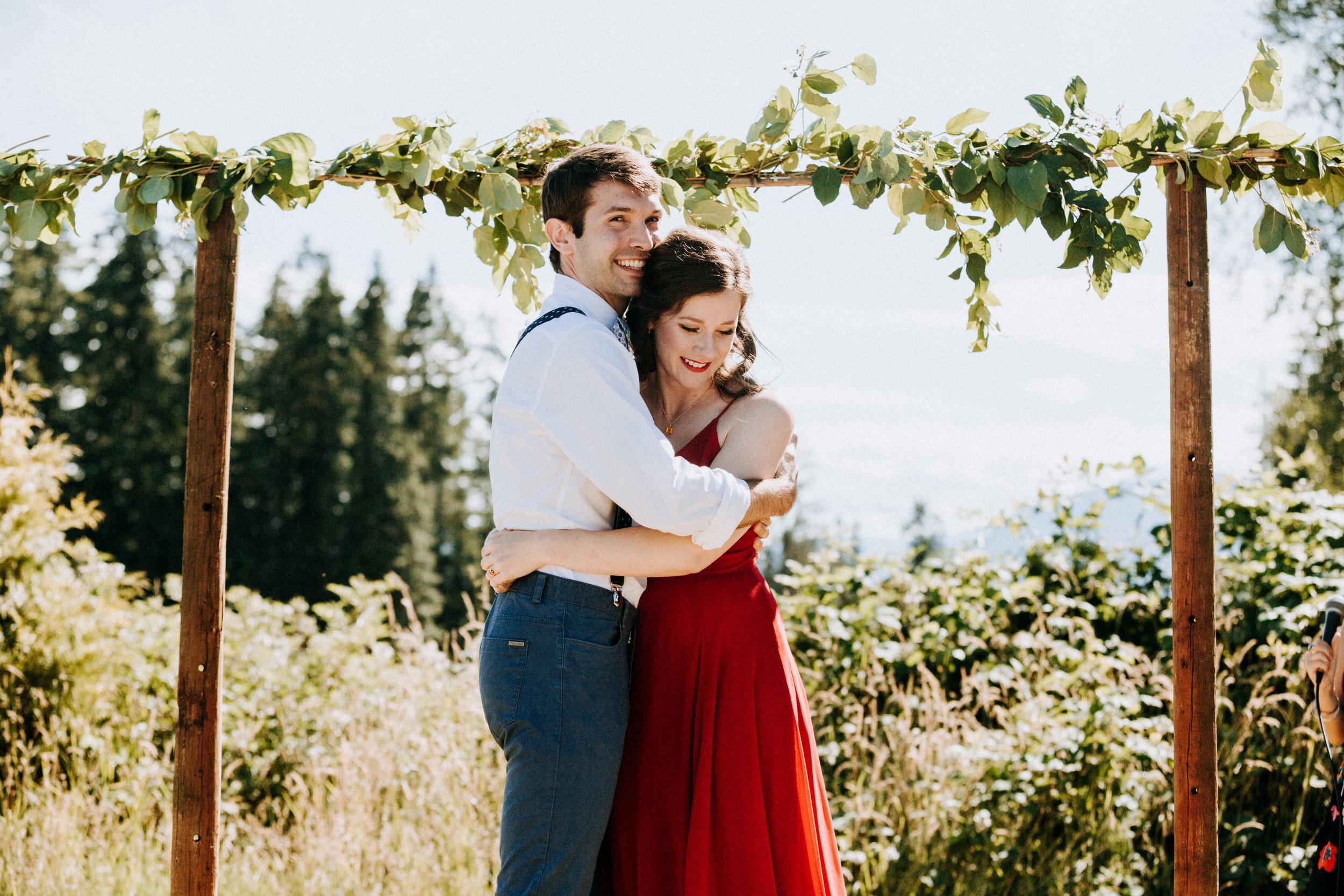 Bride and groom hug after ceremony Courtenay Wedding Photographer