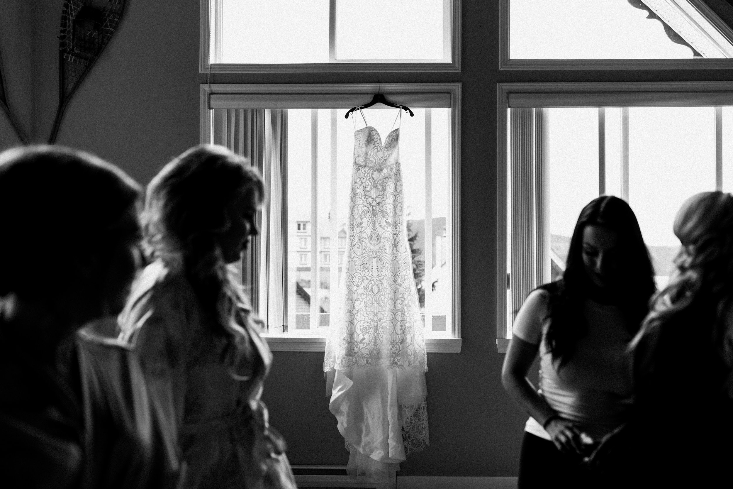 wedding dress in window at Mount Washington wedding photographer
