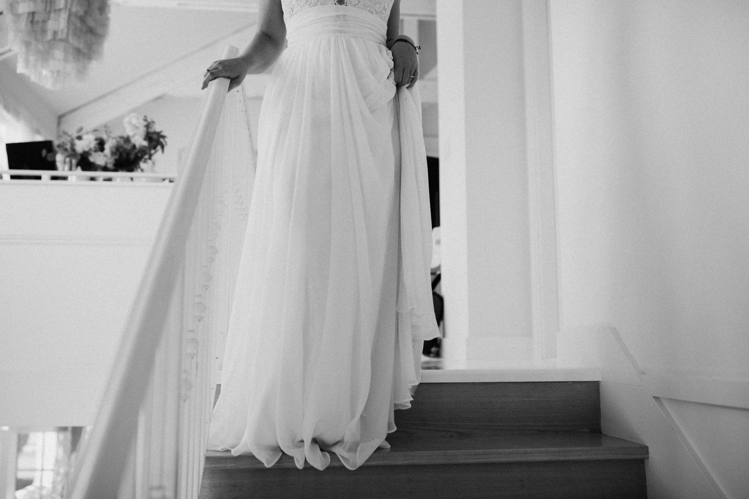 bride walking down stair West Vancouver backyard wedding photographer