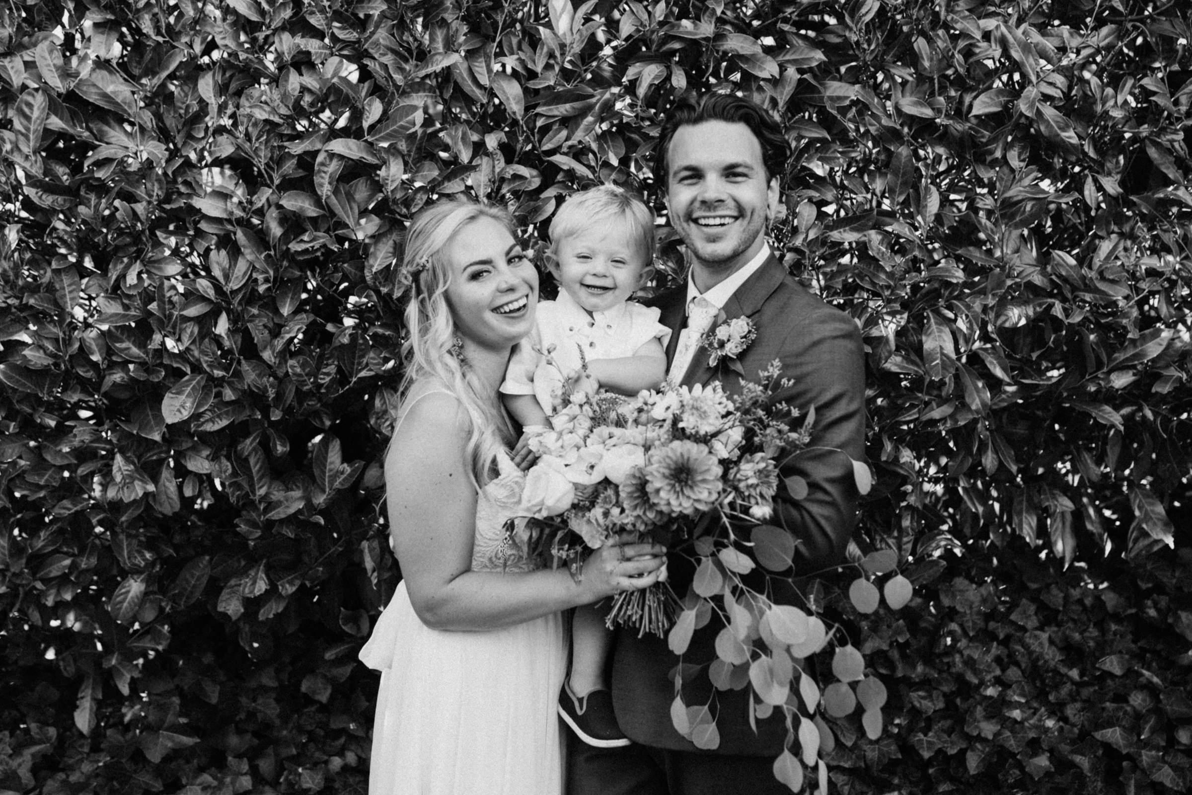 couple and their boy West Vancouver backyard wedding photographer