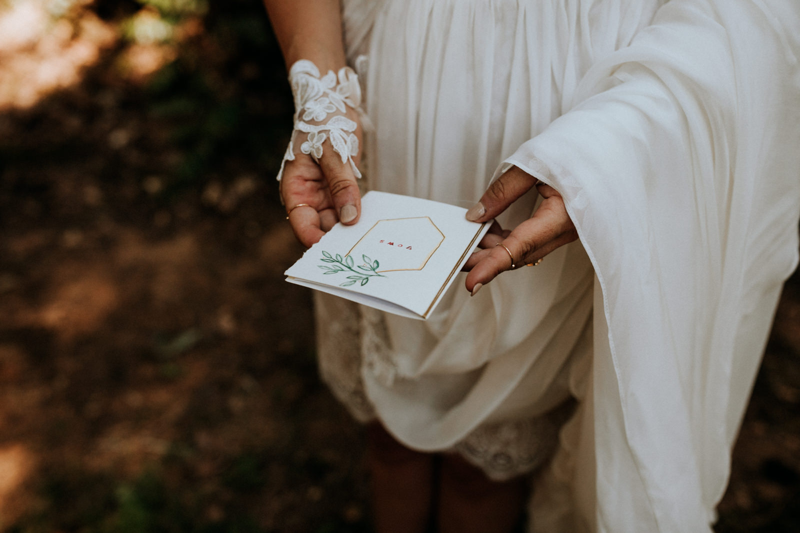 bride holds vow book at getting ready Port Alberni wedding Photographer