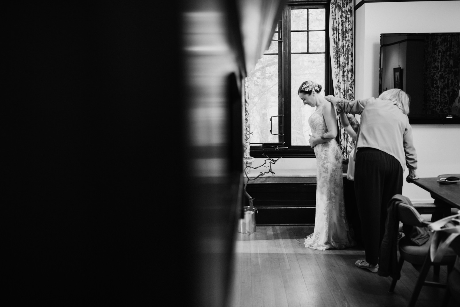 Bride getting her dress on Gower House intimate Victoria wedding photographer
