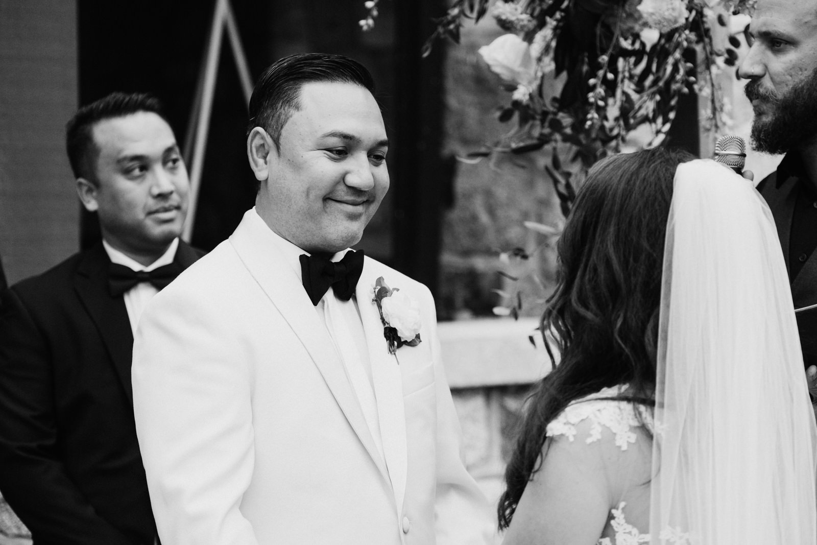 Groom smiles at bride Cecil Green Vancouver Wedding Photographer