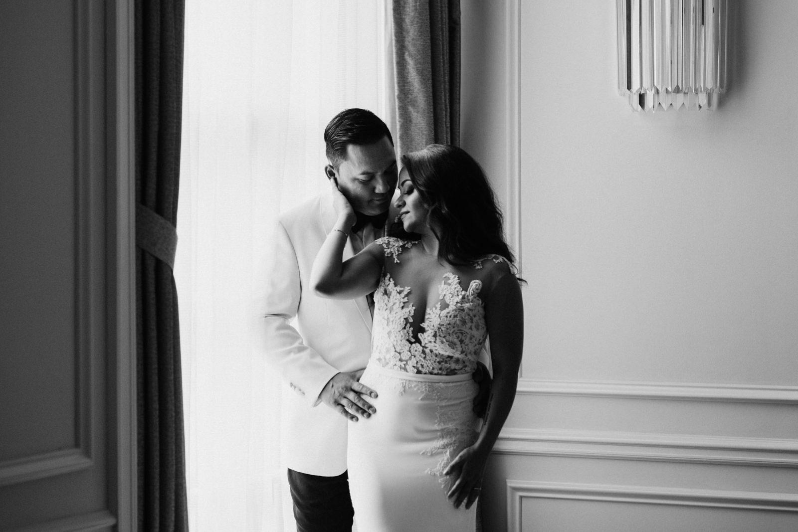 bride and groom embrace Hotel Georgia Vancouver Wedding Photographer