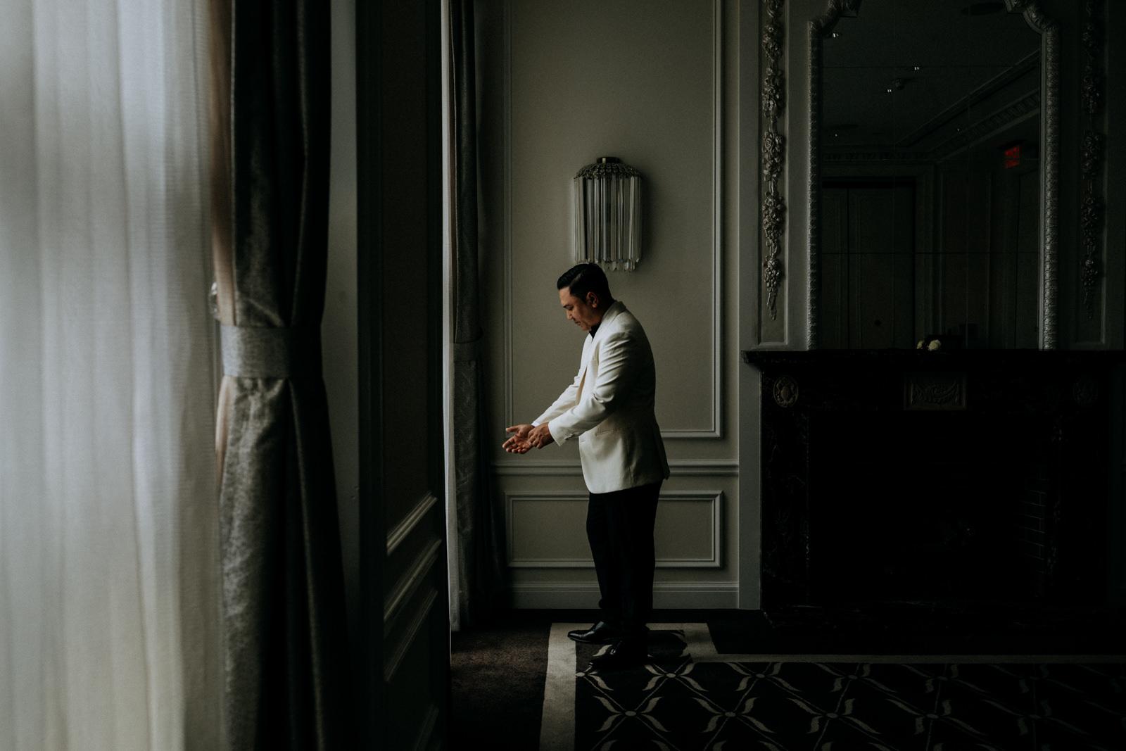 groom waits for his bride Hotel Georgia Vancouver Wedding Photographer