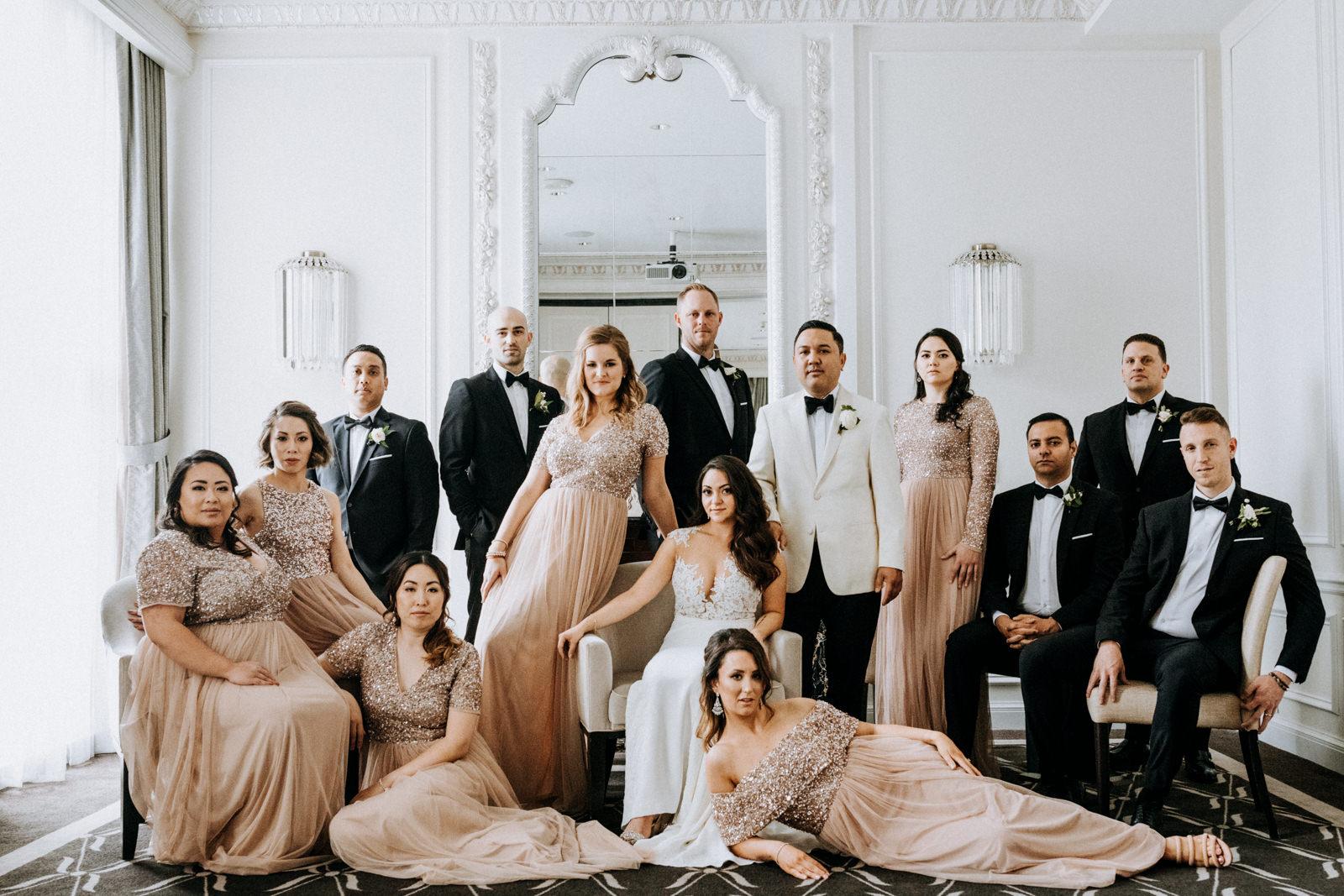 bridal party Vogue pose Hotel Georgia Vancouver Wedding Photographer