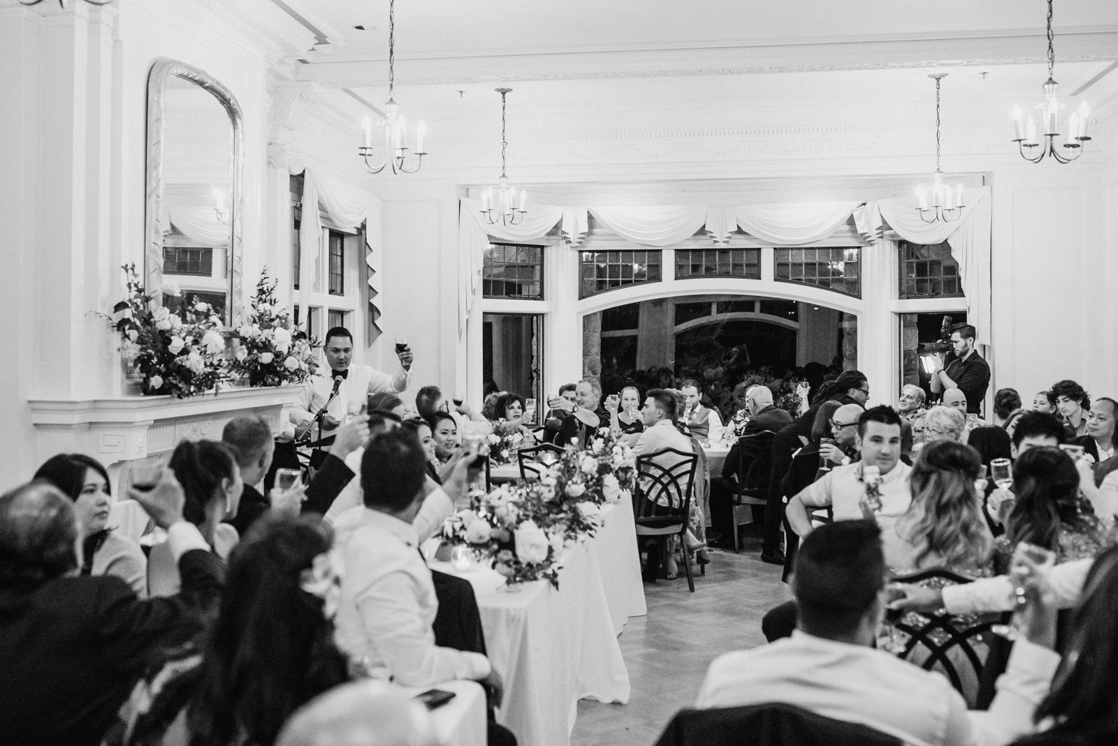 Groom toasts to bride Cecil Green Park Vancouver Wedding Photographer