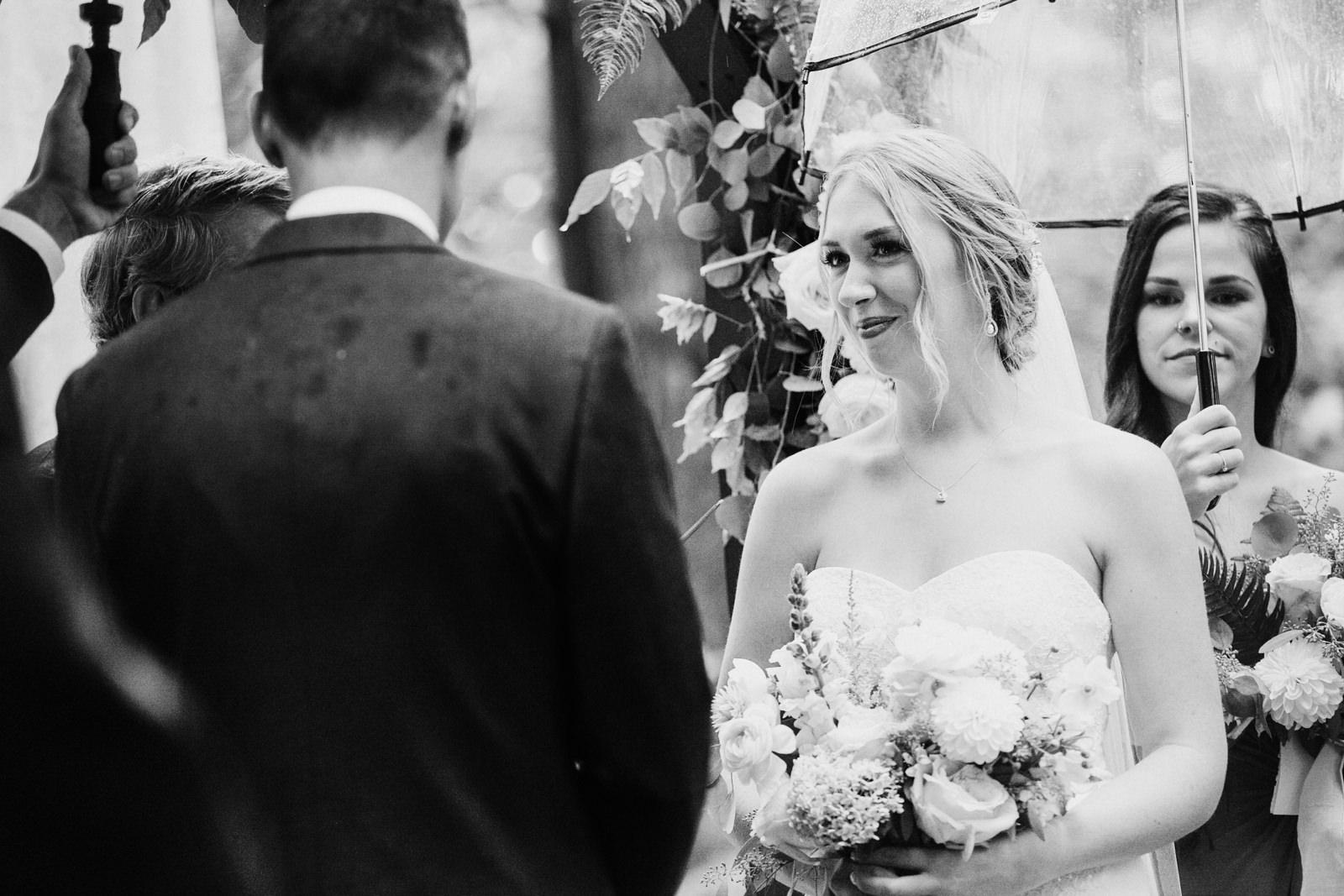 bride smiles at groom Miracle Beach ceremony Courtenay Comox wedding photographer