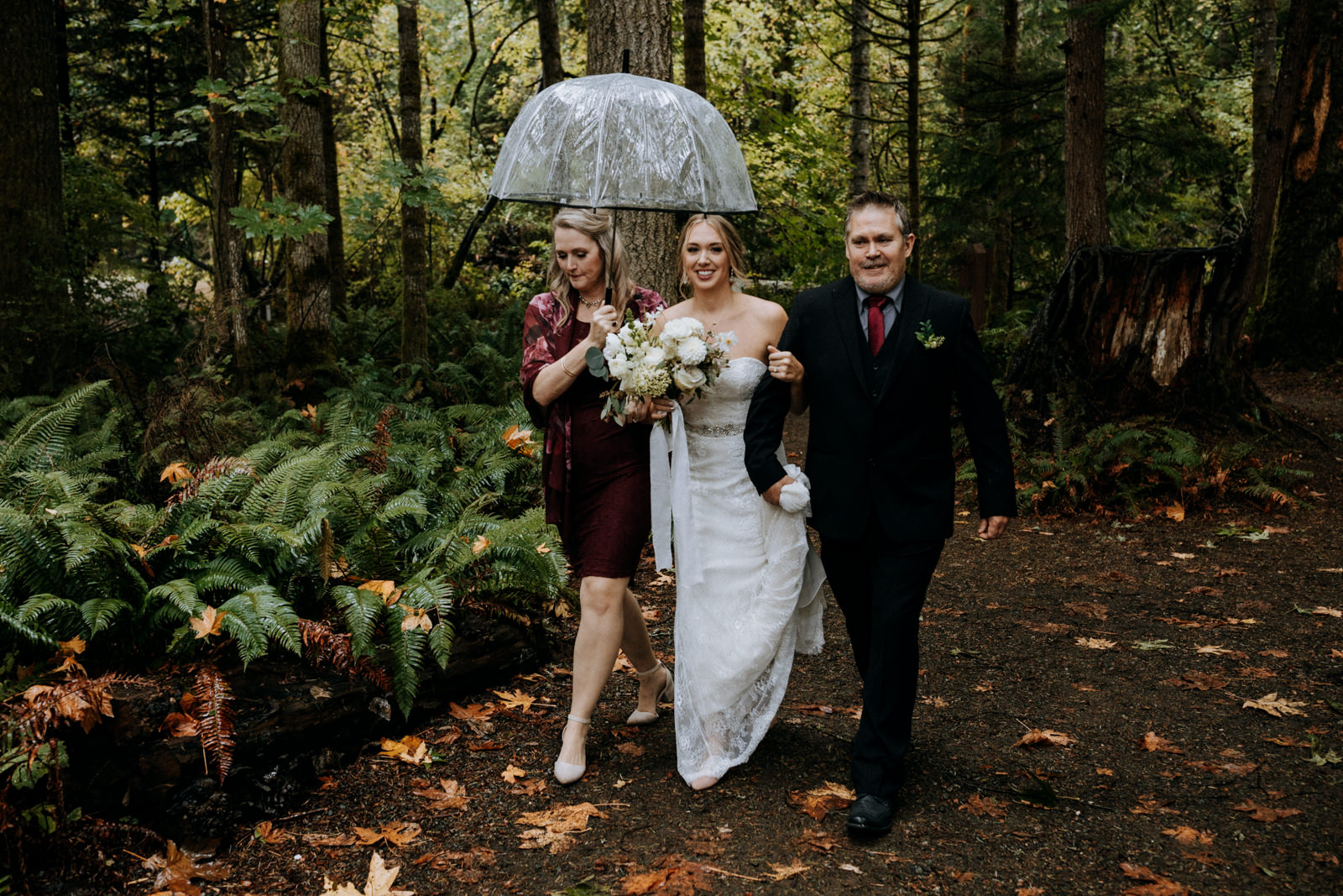 bride walks down isle family Miracle Beach Comox Wedding Photographer