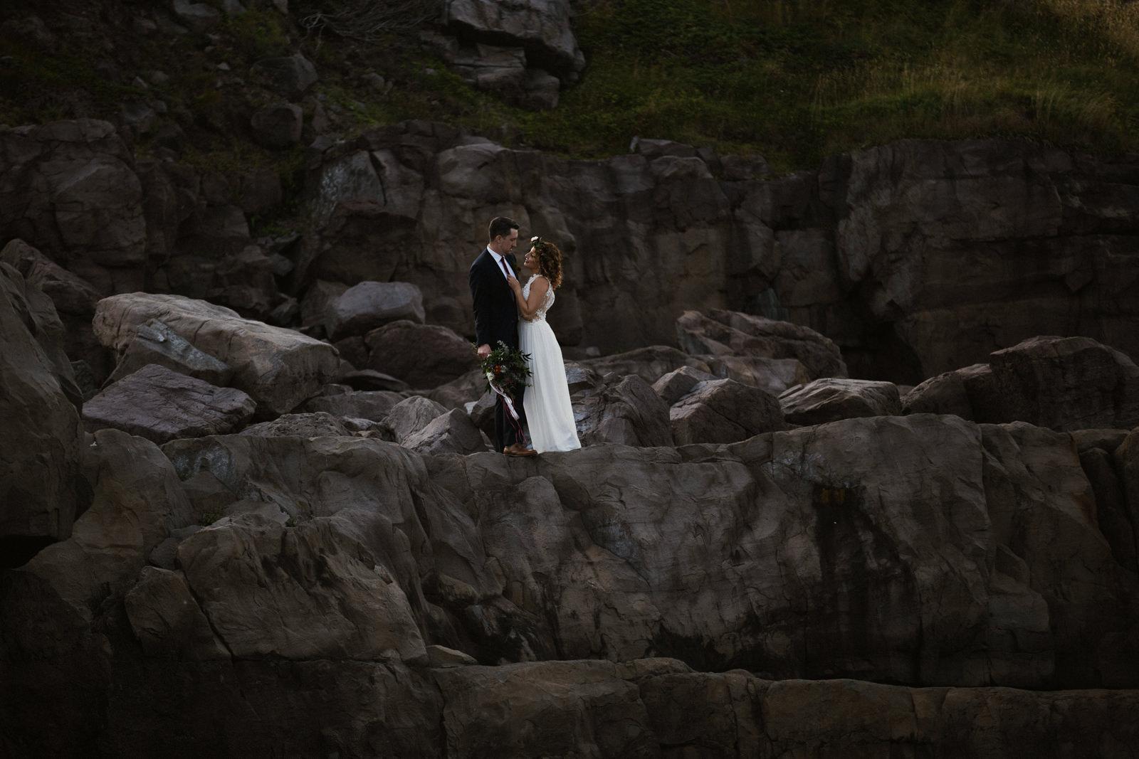 couple on rocks - cape spear newfoundland elopement photographer