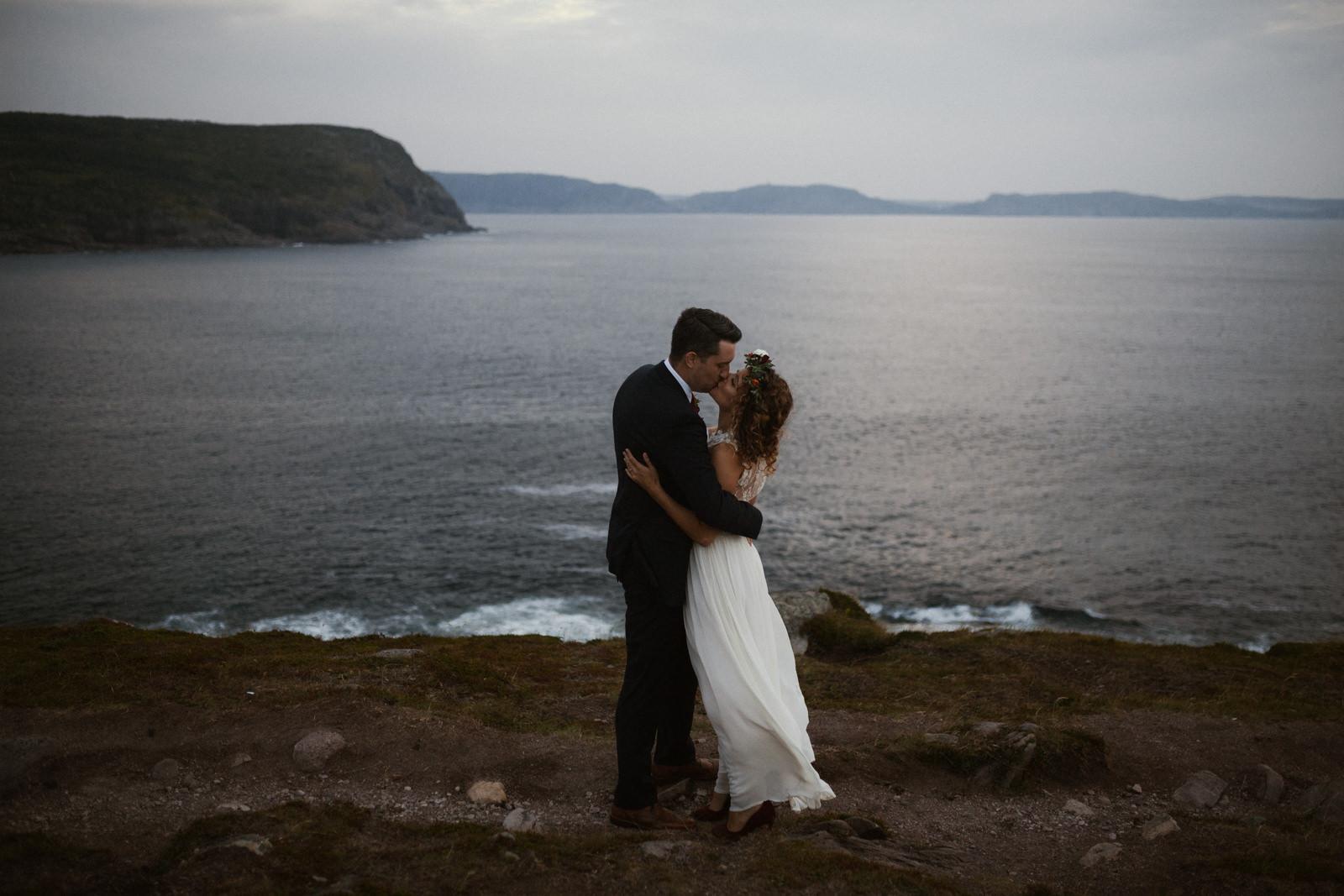 couple kisses cape spear newfoundland elopement photographer