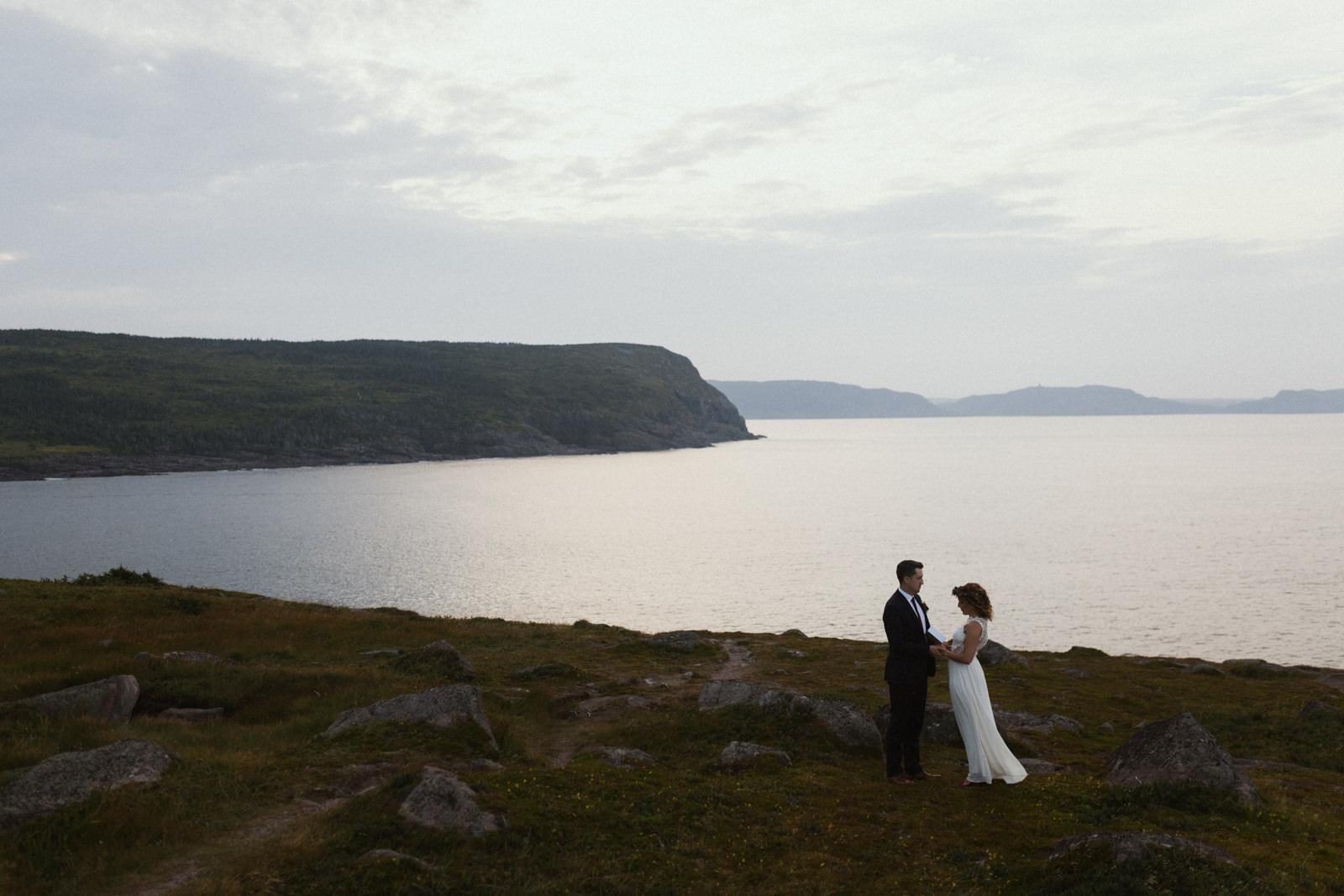 couple exchanges vows, cape spear newfoundland elopement photographer