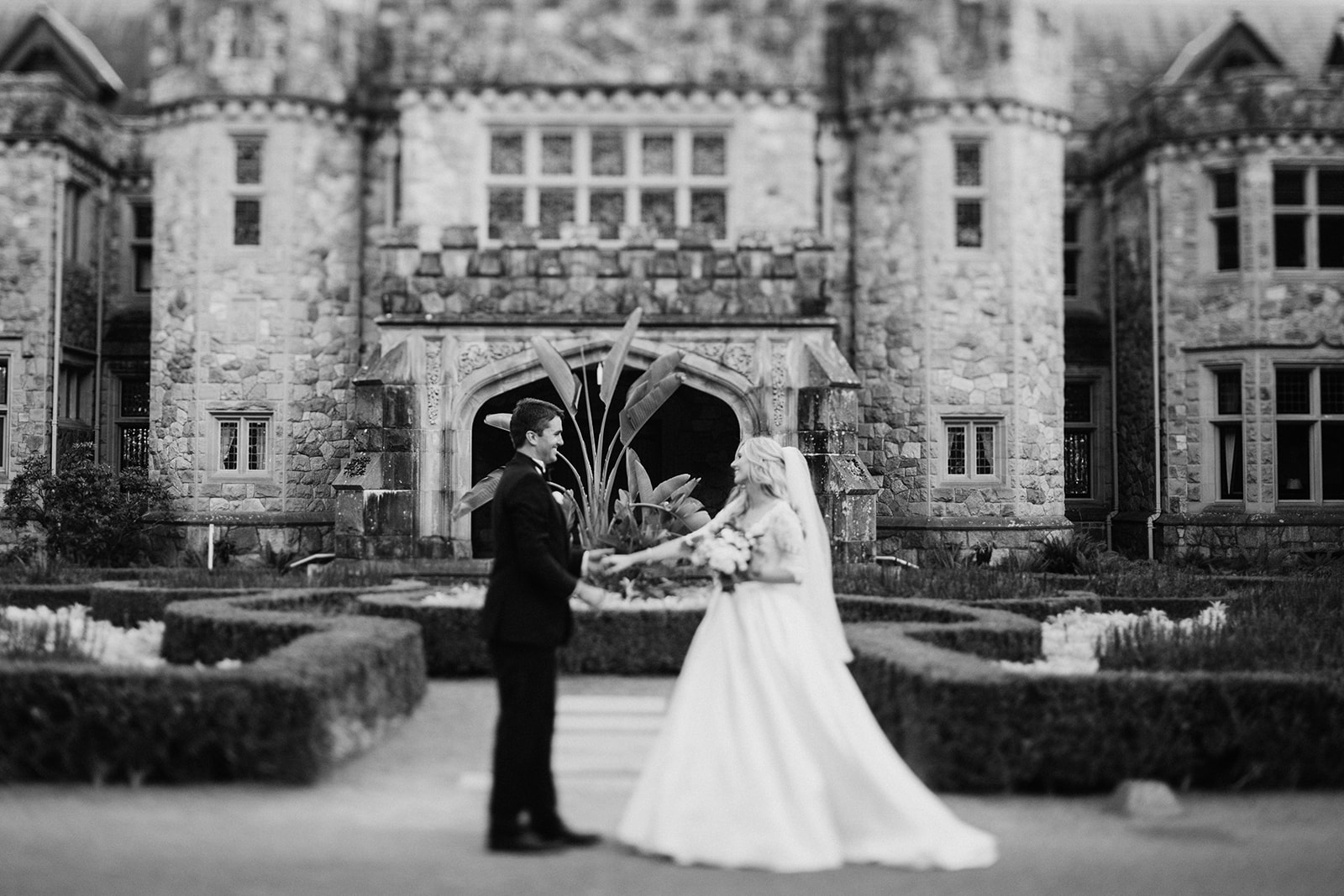 Hatley Castle Wedding photographer bride and groom in front of castle