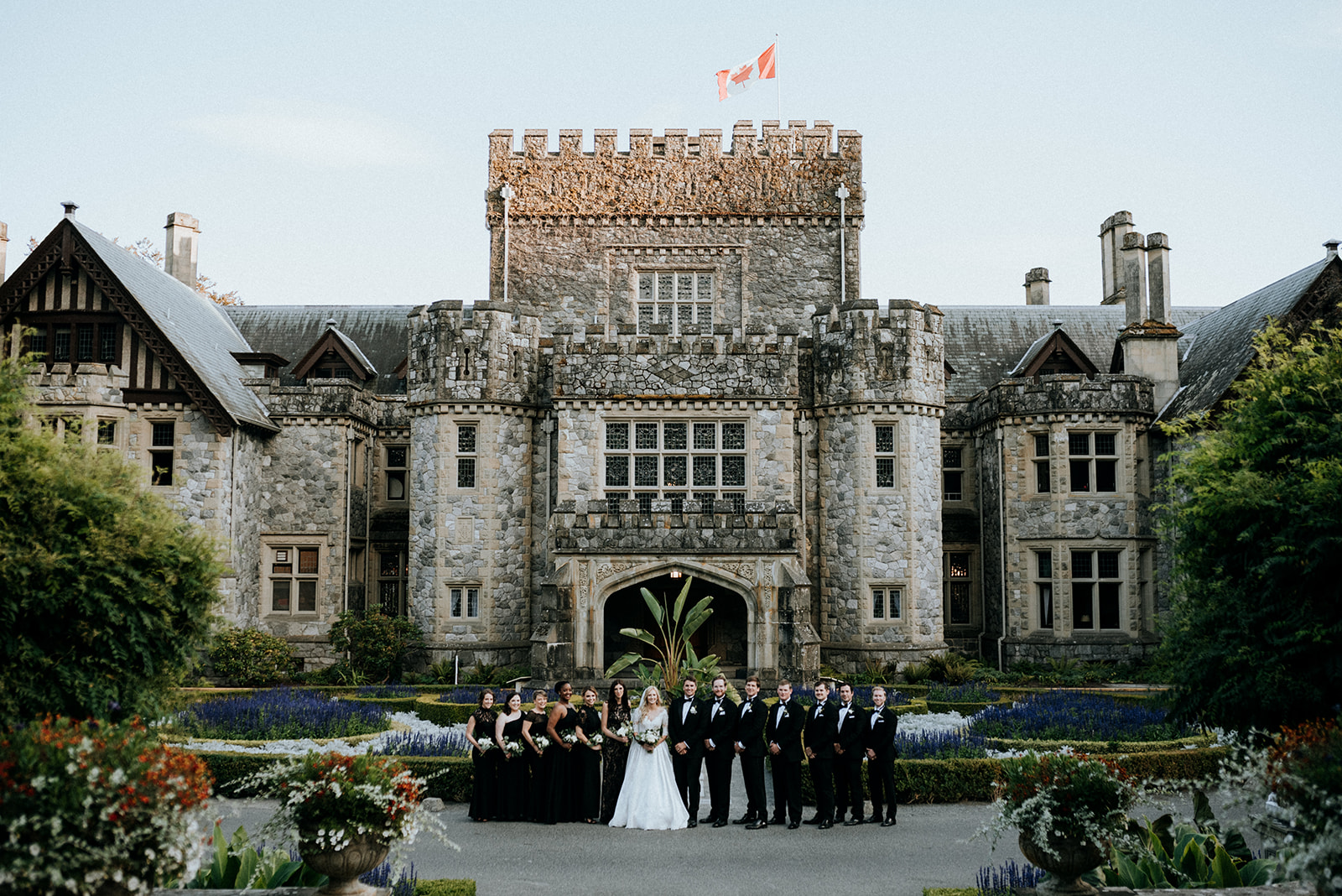 Hatley Castle Wedding photographer bridal party in front of castle