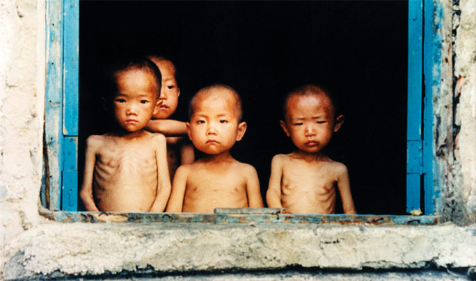 Children photographed in an orphanage in North Korea during the 1997 famine. The photo was taken by Justin Kilcullen.  Source: http://www.trocaire.org/blog/spotlight-on-north-korea