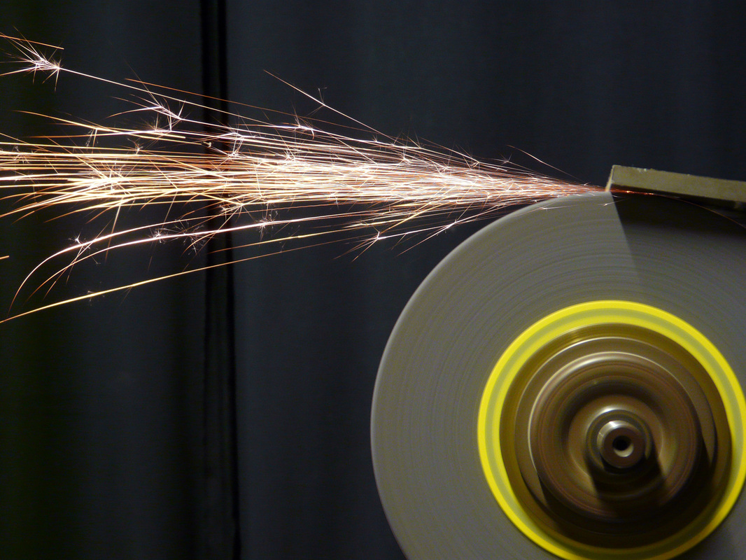 Sparks flying off tangent to a grinding wheel
