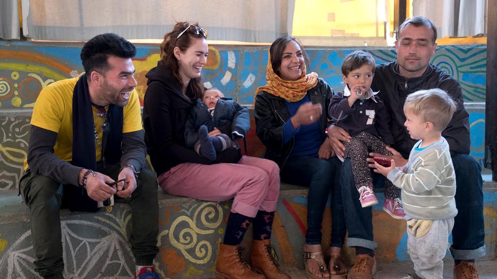 Lena Headey with a family at Kara Tepe. (Jodi Hilton/International Rescue Committee)