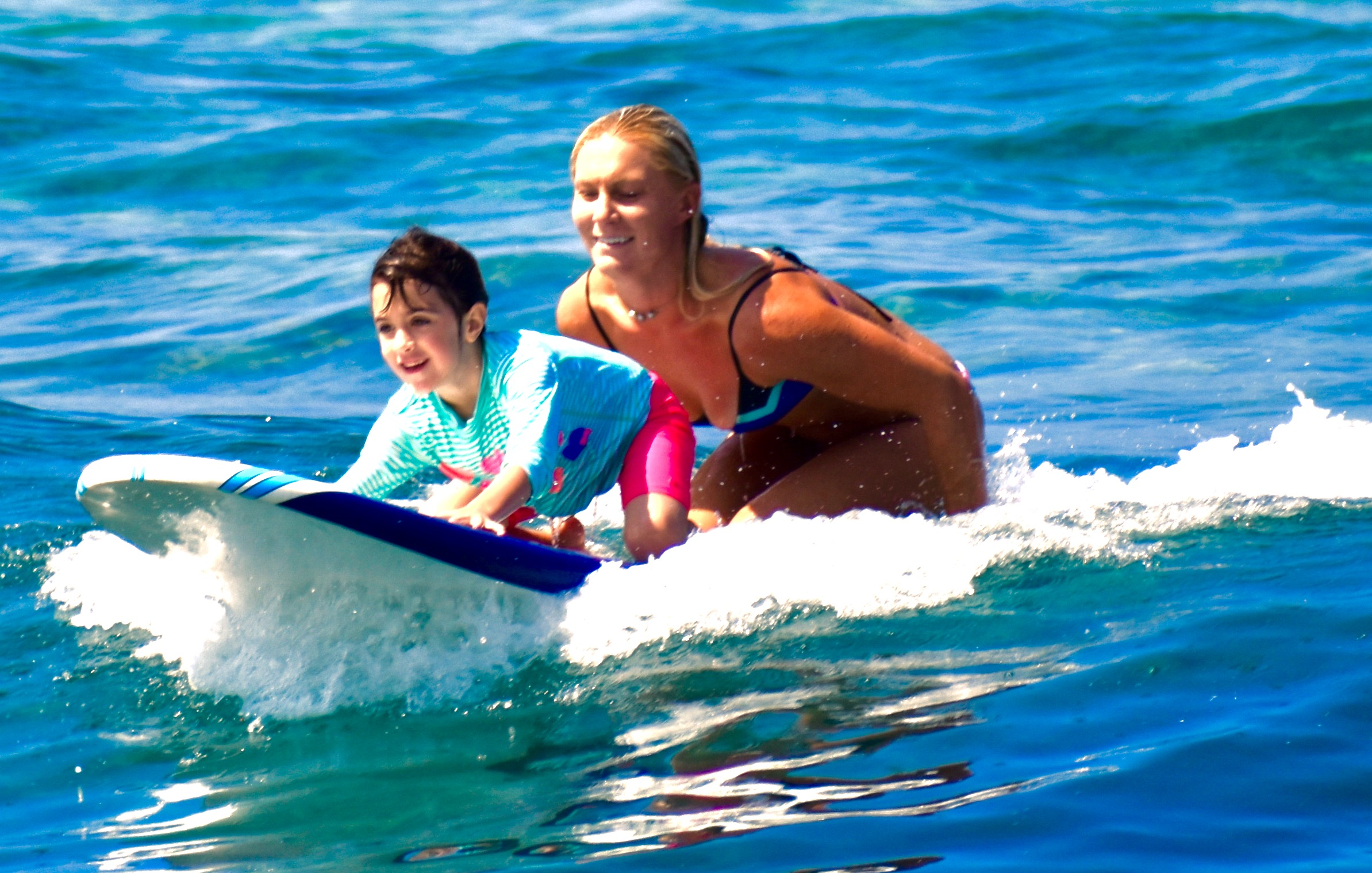 Owner Lindsay surfing with new student Penelope (age6 ) from Seattle