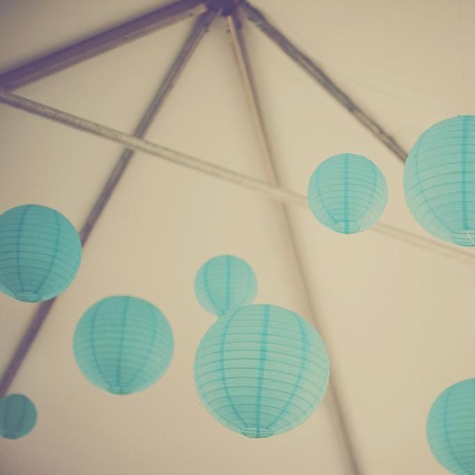 turqoise lanterns in frame tent.jpg
