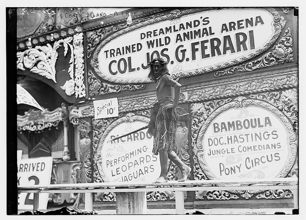 """""""Turning the tip"""" (which means, getting passersby to come see a show) at Dreamland, Coney Island, 1911 (h/t: Library of Congress)."""