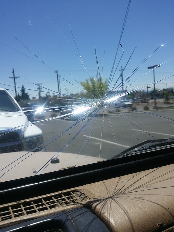 Overzealously loading redwood planks into the Jeep, I cracked the windshield.
