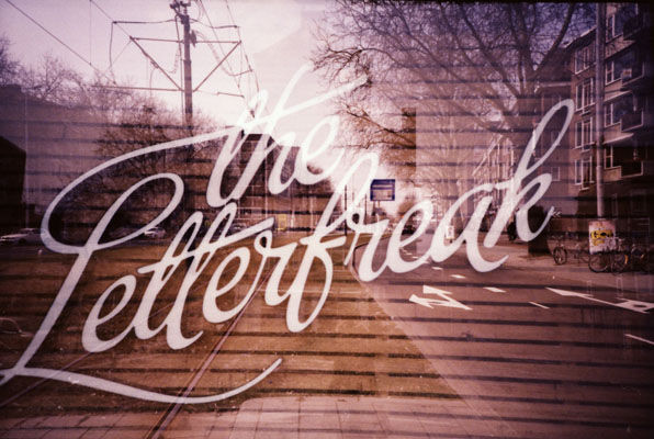 Double exposure (LC-A+ and Tungsten 64 film). I first shot the text, and then the street.