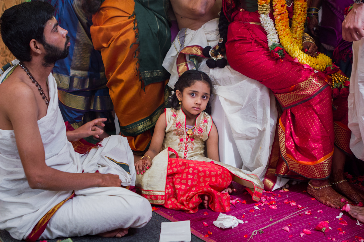 and here is Aanya, half way through the wedding, energy levels are visibly down but she hangs in there, constantly by the side of her aunt, the bride.
