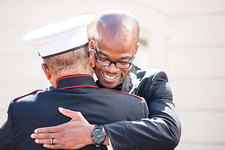 a - hotel monaco - 22 groom hugging father.jpg