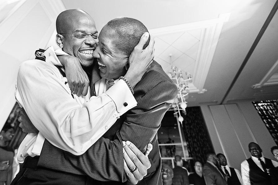 a - hotel monaco - 37 groom best man hug.jpg