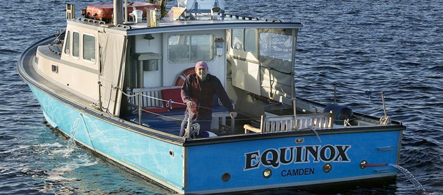 JohnMorinwithboat.jpg