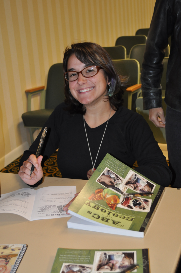 A workshop participant explores the pages of The ABCs of Ecology®.