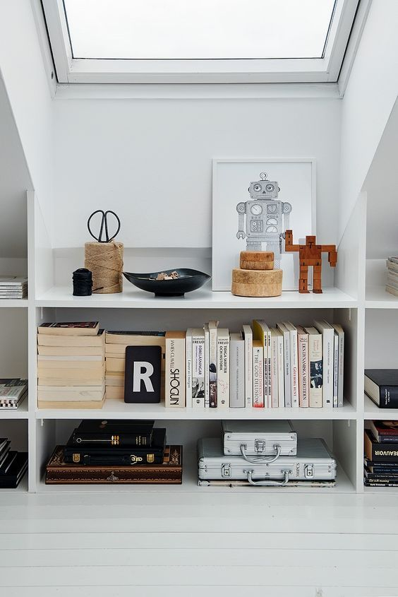 Clever use of space, shelving in eaves. Image from Pinterest