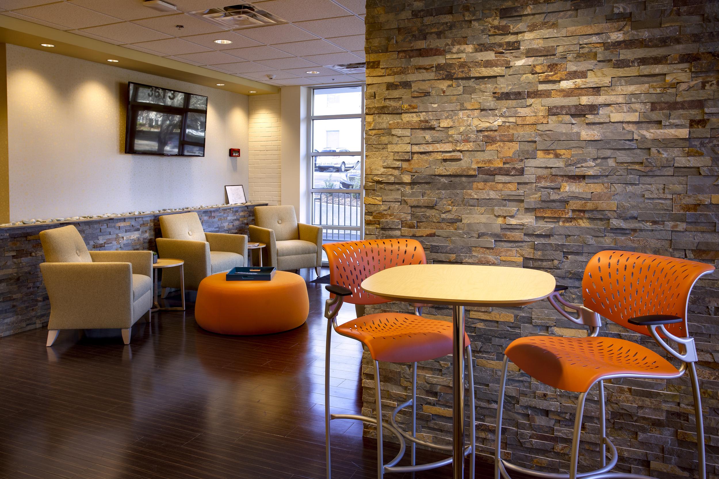 Dr-Monteith-Lobby-Orange-Chairs.jpg