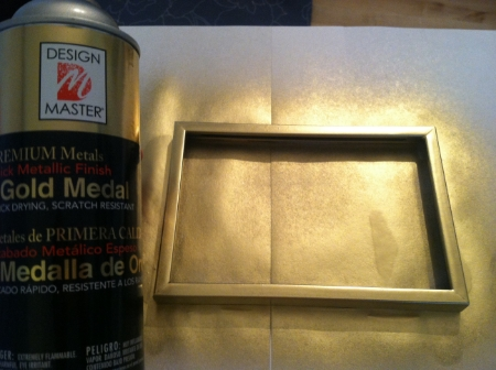"""Spray paint the frames all to match. Don't be afraid to use different types or shapes of frames - the mutual color will bring them together to make it feel like a collection. (Notice my favorite gold spray paint, Design Master's """"Gold Medal."""")"""