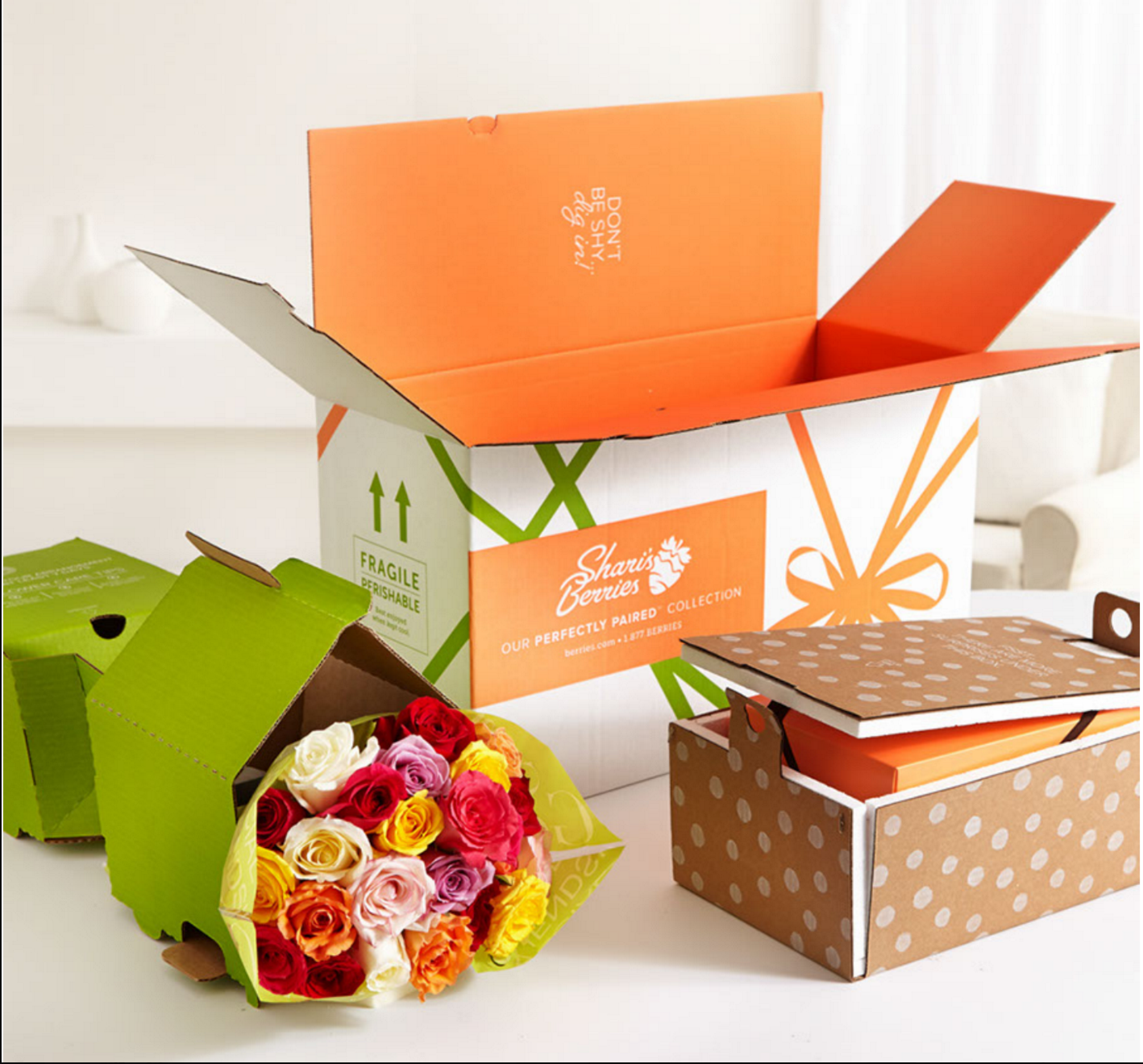 """This gift is a whopper - a bouquet of flowers paired with sweet dipped berries or truffle treats. As the recipient opens the gift, they're met with fun lines such as """"Don't be shy - dig in"""" and """"sharing is optional."""""""