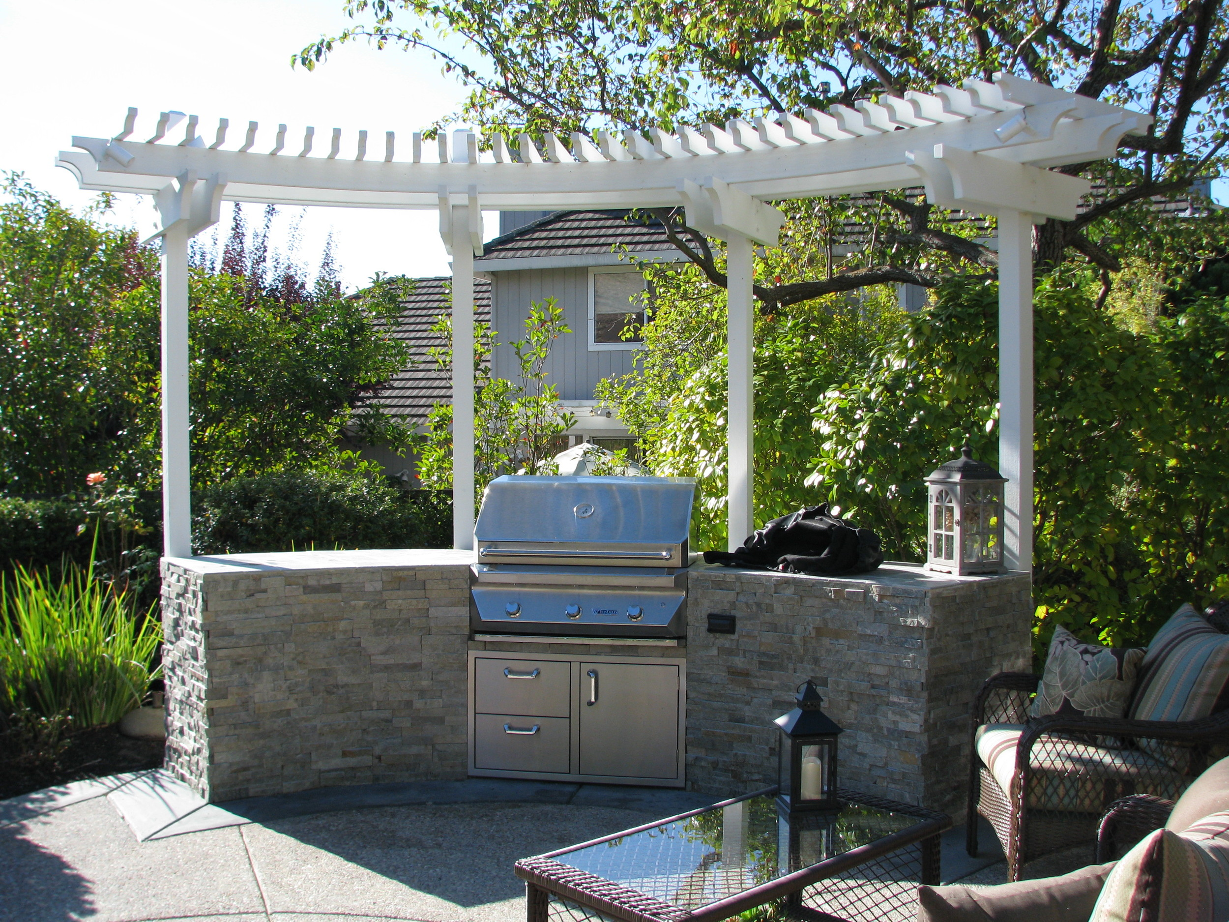 BBQ island and arbor for outdoor cooking and entertaining