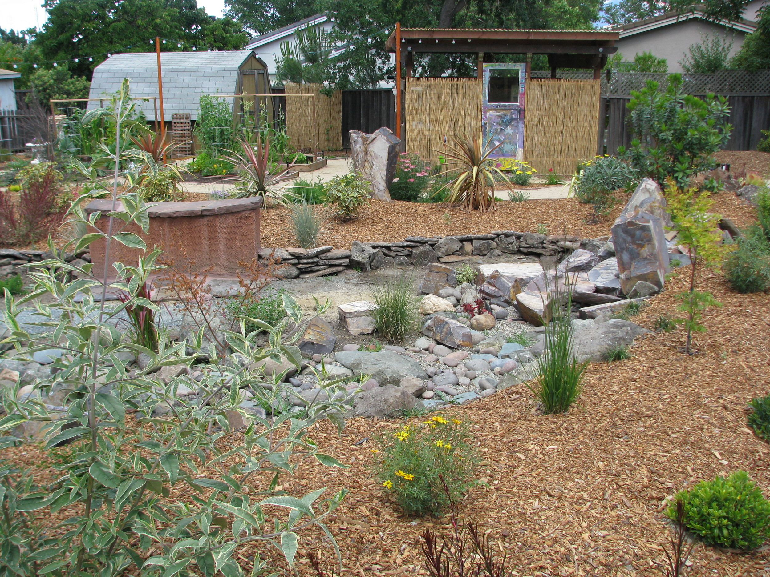 No paving, using decomposed granite and gravel for maximum water retention.