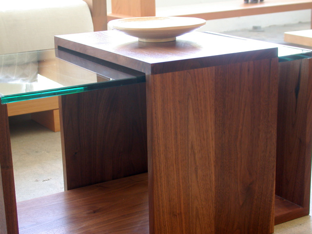 shown in solid walnut and glass