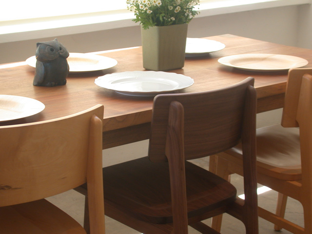 shown in solid walnut with  lucke chairs