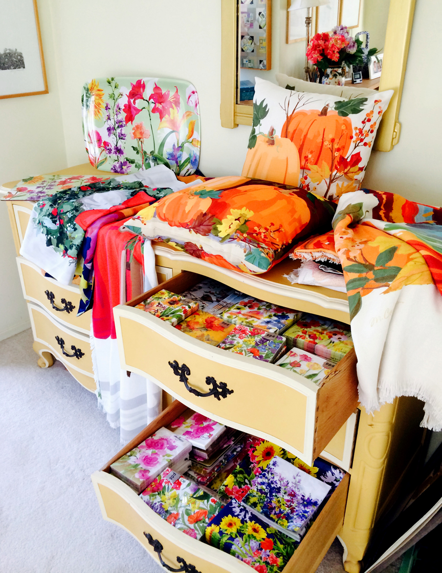 Melamine tray, hardback placemat, Fall/ Holiday wall hangings and throws, pillows, & paper tableware.