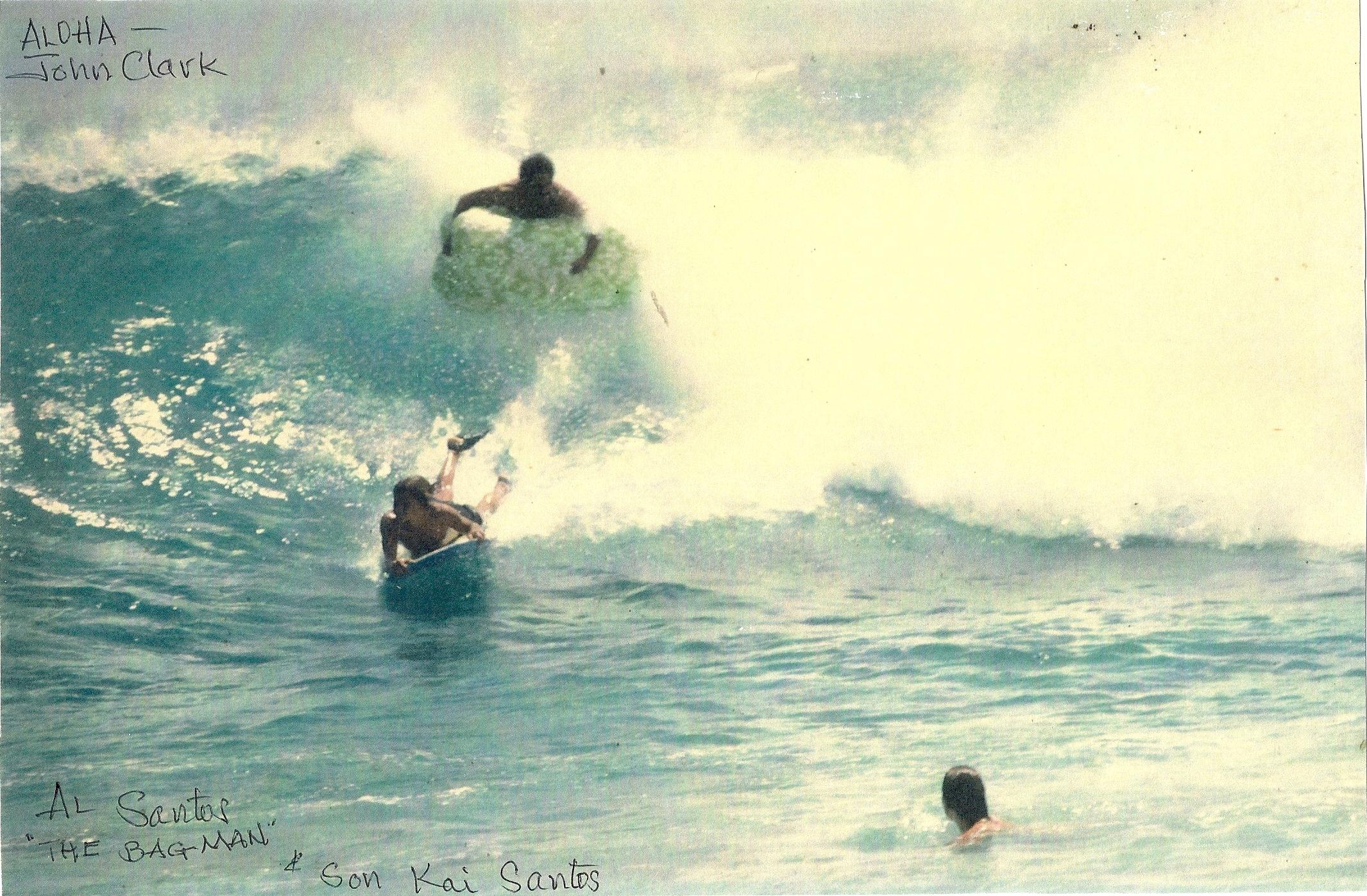 Al Santos surfing with his son Kai Santos on the bodyboard. Sandy Beach, Oahu. 1968